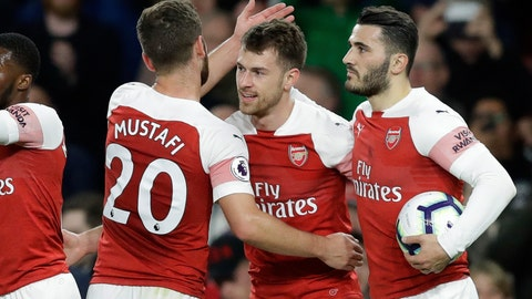 <p>               Arsenal's Aaron Ramsey, center, celebrates scores his side's first goal during the English Premier League soccer match between Arsenal and Newcastle United at Emirates stadium in London, Monday, April 1, 2019. (AP Photo/Kirsty Wigglesworth)             </p>