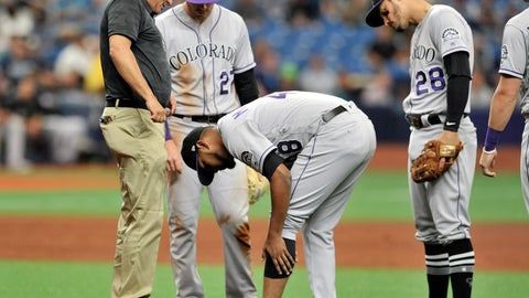 <p>               Teammates look on as Colorado Rockies pitcher German Marquez checks his leg after he was hit on the mound by a ground ball from Tampa Bay Rays' Kevin Kiermaier during the fifth inning of a baseball game Wednesday, April 3, 2019, in St. Petersburg, Fla. Marquez made the play and threw out Kiermaier at first base. (AP Photo/Steve Nesius)             </p>