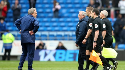 <p>               Cardiff City manager Neil Warnock, left, stands on the pitch after Chelsea won the match 2-1, during the English Premier League soccer match at the Cardiff City Stadium in Cardiff, Wales, Sunday March 31, 2019. (Nick Potts/PA via AP)             </p>