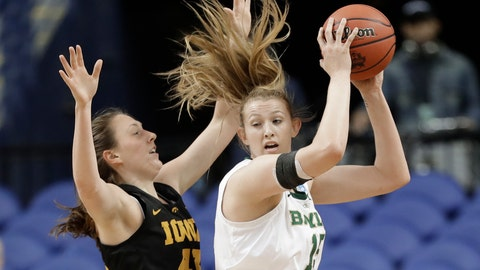 <p>               Baylor's Lauren Cox, right, drives against Iowa's Amanda Ollinger, left, during the first half of a regional final women's college basketball game in the NCAA Tournament in Greensboro, N.C., Monday, April 1, 2019. (AP Photo/Chuck Burton)             </p>