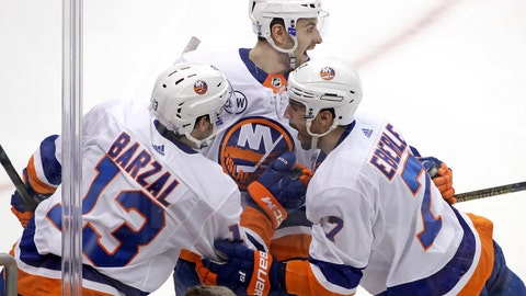 <p>               New York Islanders' Jordan Eberle (7) celebrates with Adam Pelech, center, and Mathew Barzal (13) after scoring against the Pittsburg Penguins during the first period in Game 4 of an NHL first-round hockey playoff series in Pittsburgh, Tuesday, April 16, 2019. (AP Photo/Gene J. Puskar)             </p>