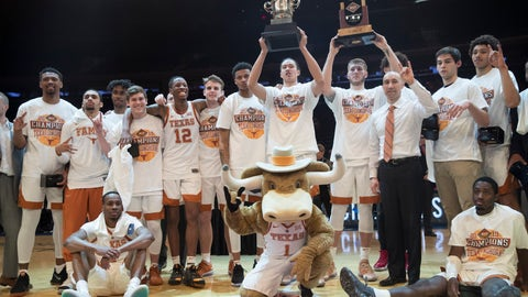 <p>               Texas players and coach Shaka Smart pose for photographers with their trophies after defeating Lipscomb during an NCAA college basketball game for the NIT championship Thursday, April 4, 2019, at Madison Square Garden in New York. Texas won 81-66. (AP Photo/Mary Altaffer)             </p>