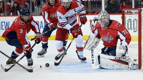<p>               Washington Capitals defenseman Nick Jensen (3) and goaltender Braden Holtby (70) battle for the puck against Carolina Hurricanes right wing Justin Williams (14) during the first period of Game 2 of an NHL hockey first-round playoff series, Saturday, April 13, 2019, in Washington. (AP Photo/Nick Wass)             </p>