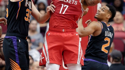 <p>               Houston Rockets forward PJ Tucker (17) pulls down a rebound between Phoenix Suns forward Dragan Bender (35) and guard Elie Okobo (2) during the first half of an NBA basketball game Sunday, April 7, 2019, in Houston. (AP Photo/Michael Wyke)             </p>