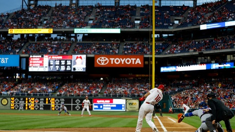 <p>               Philadelphia Phillies' J.T. Realmuto hits a two-run double off New York Mets starting pitcher Steven Matz during the first inning of a baseball game, Tuesday, April 16, 2019, in Philadelphia. (AP Photo/Matt Slocum)             </p>