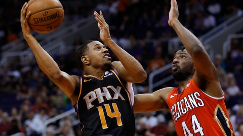 <p>               Phoenix Suns guard De'Anthony Melton (14) shoots over New Orleans Pelicans forward Solomon Hill during the second half of an NBA basketball game Friday, April 5, 2019, in Phoenix. The Suns won 133-126 in overtime. (AP Photo/Rick Scuteri)             </p>