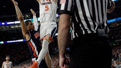<p>               Virginia's Kyle Guy (5) takes a shot as Auburn's Samir Doughty (10) was called foul during the second half in the semifinals of the Final Four NCAA college basketball tournament, Saturday, April 6, 2019, in Minneapolis. (AP Photo/David J. Phillip)             </p>