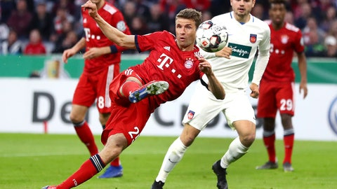 <p>               Munich's Thomas Mueller scores his side's equalizing goal during the German Soccer Cup match between FC Bayern Munich and 1. FC Heidenheim in Munich, Germany, Wednesday, April 3, 2019. (AP Photo/Matthias Schrader)             </p>