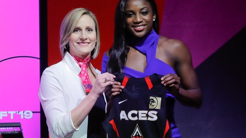 <p>               RETRANSMISSION TO CORRECT SPELLING OF NAME - Notre Dame's Jackie Young, right, poses for a photo with WNBA COO Christy Hedgpeth after being selected as the number one pick in the draft by the Las Vegas Aces in the WNBA basketball draft, Wednesday, April 10, 2019, in New York. (AP Photo/Julie Jacobson)             </p>
