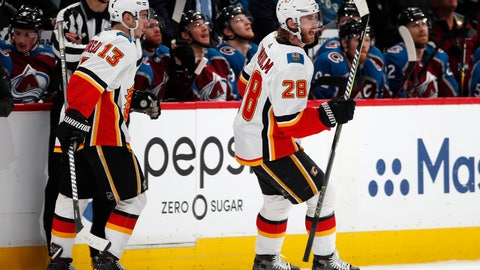 <p>               Calgary Flames center Elias Lindholm, right, celebrates his goal with left wing Johnny Gaudreau during the second period of Game 4 of an NHL hockey playoff series against the Colorado Avalanche on Wednesday, April 17, 2019, in Denver. (AP Photo/David Zalubowski)             </p>