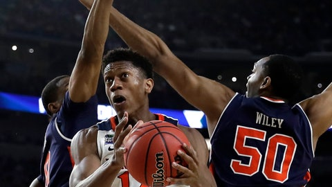 <p>               Virginia guard De'Andre Hunter (12) drives to the basket past Auburn center Austin Wiley, right, during the second half in the semifinals of the Final Four NCAA college basketball tournament, Saturday, April 6, 2019, in Minneapolis. (AP Photo/David J. Phillip)             </p>