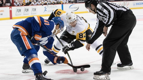 <p>               FILE - In this Nov. 1, 2018, file photo, Pittsburgh Penguins center Sidney Crosby (87) faces off against New York Islanders center Valtteri Filppula (51) during the first period of an NHL hockey game, in New York. The Penguins and Islanders will face each other in a first round playoff series beginning Wednesday, April 9, 2019. (AP Photo/Mary Altaffer, File)             </p>