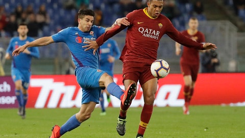 <p>               Fiorentina's Giovanni Simeone, left, challenges for the ball with Roma's Juan Jesus during the Serie A soccer match between Roma and Fiorentina at the Rome Olympic stadium, Wednesday, April 3, 2019. (AP Photo/Andrew Medichini)             </p>