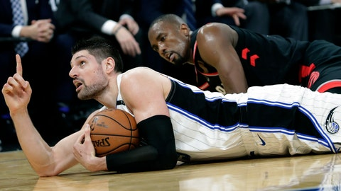<p>               Orlando Magic's Nikola Vucevic, left, points upward after grabbing the ball away from Toronto Raptors' Serge Ibaka, right, and calling a timeout during the second half in Game 3 of a first-round NBA basketball playoff series, Friday, April 19, 2019, in Orlando, Fla. (AP Photo/John Raoux)             </p>