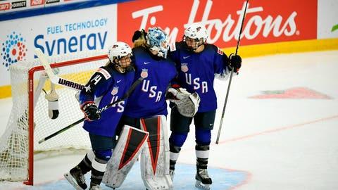 <p>               Brianna Decker, left, Alex Rigsby and Cayla Barnes of USA celebrate winning the 2019 IIHF Women's World Championships preliminary match between USA and Canada in Espoo, Finland, Saturday April 6, 2019. (Antti Aimo-Koivisto/Lehtikuva via AP)             </p>