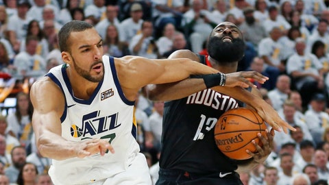 <p>               Utah Jazz center Rudy Gobert, left, fouls Houston Rockets guard James Harden (13) as he drives to the basket in the first half during Game 4 of a first-round NBA basketball playoff series, Monday, April 22, 2019, in Salt Lake City. (AP Photo/Rick Bowmer)             </p>