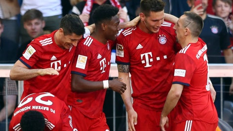 <p>               Bayern defender Niklas Suele, center right, celebrates with teammates after scoring his side's opening goal during the German Bundesliga soccer match between Bayern Munich and Werder Bremen at the Allianz Arena in Munich, Germany, Saturday, April 20, 2019. (AP Photo/Matthias Schrader)             </p>