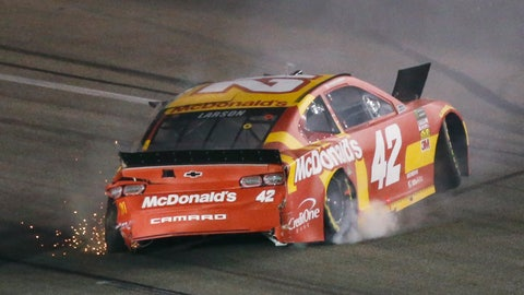 <p>               Kyle Larson backs his car down the track after he spun during the NASCAR Cup series auto race at Richmond Raceway in Richmond, Va., Saturday, April 13, 2019. (AP Photo/Steve Helber)             </p>