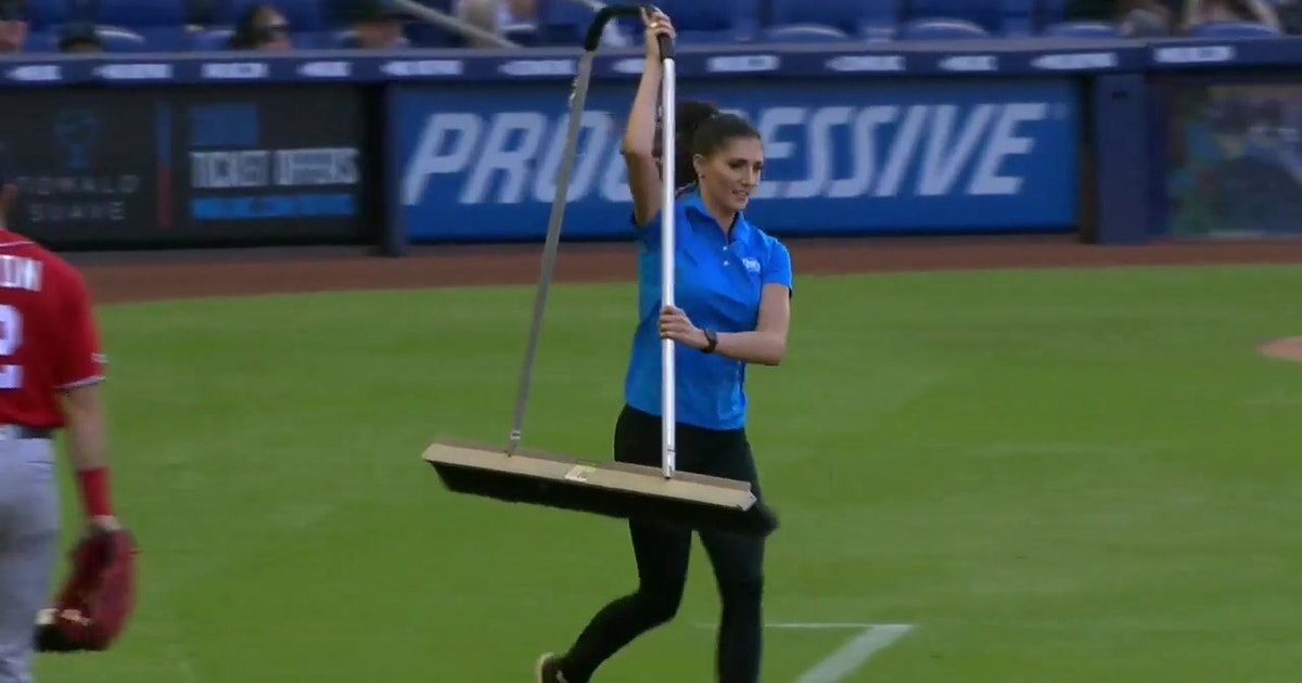 Kelly Saco lends a helping hand to the Marlins grounds crew