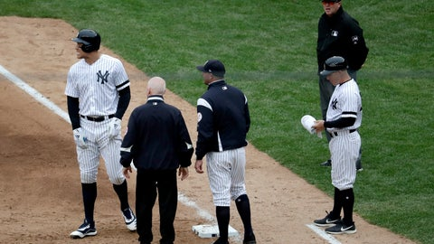 <p>               New York Yankees' Aaron Judge, left, reacts while talking to a trainer and bench coach Josh Bard, center, after hitting a single to right field during the sixth inning of a baseball game against the Kansas City Royals, Saturday, April 20, 2019, in New York. Judge left the game with an apparent injury. (AP Photo/Julio Cortez)             </p>