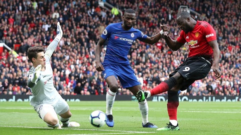 <p>               Manchester United's Romelu Lukaku, right, has a shot blocked by Chelsea goalkeeper Kepa Arrizabalaga, left, and Antonio Rudiger during their English Premier League soccer match at Old Trafford, Manchester, England, Sunday, April 28, 2019. (Martin Rickett/PA via AP)             </p>