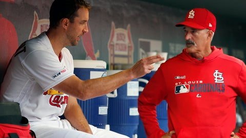 <p>               St. Louis Cardinals starting pitcher Adam Wainwright, left, talks with pitching coach Mike Maddux after working the sixth inning of a baseball game against the Milwaukee Brewers Wednesday, April 24, 2019, in St. Louis. (AP Photo/Jeff Roberson)             </p>