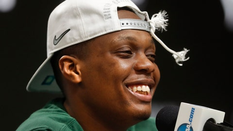 <p>               FILE - In this March 31, 2019, file photo, Michigan State guard Cassius Winston (5) smiles while answering questions during a news conference after beating Duke 68-67 in an NCAA men's East Regional final college basketball game, in Washington. Winston has joined a select group of players in program history as an All-America player and Big Ten player of the year. If he can help the Spartans win two more games, he'll join Magic Johnson and Mateen Cleaves as the school's national championship-winning point guards. (AP Photo/ Mark Tenally, File)             </p>