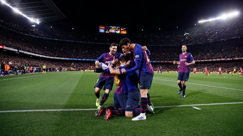 <p>               Barcelona players hug teammate Luis Suarez after he scores his side's first goal during a Spanish La Liga soccer match between FC Barcelona and Atletico Madrid at the Camp Nou stadium in Barcelona, Spain, Saturday April 6, 2019. (AP Photo/Manu Fernandez)             </p>