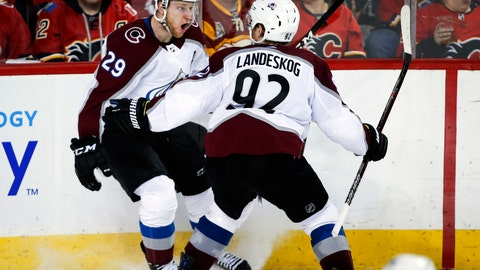 <p>               Colorado Avalanche center Nathan MacKinnon (29) celebrates his game-winning goal against the Calgary Flames with teammate Gabriel Landeskog (92) during overtime of an NHL hockey playoff game in Calgary, Alberta, Saturday, April 13, 2019. (Jeff McIntosh/The Canadian Press via AP)             </p>