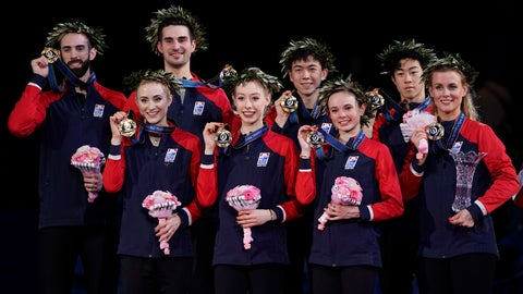 <p>               Members of the U.S. team, from left in front low, Ashley Cain, Bradie Tennell, Mariah Bell, Madison Hubbell, from left in the background, Timothy Leduc, Zachary Donohue, Vincent Zhou and Nathan Chen pose with their gold medals for photographer during an award ceremony of the ISU World Team Trophy Figure Skating competition Saturday, April 13, 2019 in Fukuoka, southwestern Japan. (AP Photo/Toru Hanai)             </p>