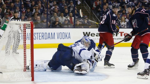 <p>               Tampa Bay Lightning's Andrei Vasilevskiy, left, of Russia, gives up a goal as Columbus Blue Jackets' Pierre-Luc Dubois, center, and Josh Anderson watch the play during the second period of Game 3 of an NHL hockey first-round playoff series Sunday, April 14, 2019, in Columbus, Ohio. (AP Photo/Jay LaPrete)             </p>
