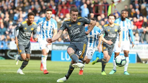 <p>               Leicester City's Jamie Vardy scores against Huddersfield Town during the English Premier League soccer match at the John Smith's Stadium, Huddersfield, England, Saturday April 6, 2019. (Martin Rickett/PA via AP)             </p>