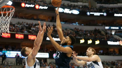 <p>               Minnesota Timberwolves center Karl-Anthony Towns (32) shoots against Dallas Mavericks defenders Dwight Powell (7) and Dirk Nowitzki (41) during the first half of an NBA basketball game in Dallas, Wednesday, April 3, 2019. (AP Photo/LM Otero)             </p>