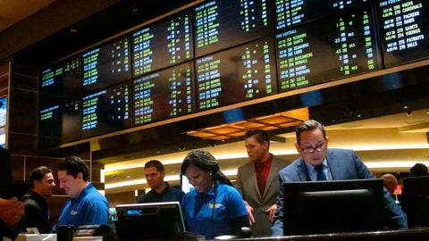 <p>               FILE - In this Oct. 25, 2018, file photo, employees prepare to take bets moments before the new sports book at the Tropicana casino in Atlantic City, N.J., opened. Most of the states that moved quickly to legalize sports betting after a Supreme Court decision last year are still waiting for the expected payoff. Only New Jersey and Delaware saw the tax revenue to their state budgets meet projections. (AP Photo/Wayne Parry, File)             </p>