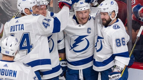 <p>               Tampa Bay Lightning center Steven Stamkos, second from right, celebrates with teammates after scoring the first goal during the first period of an NHL hockey game against the Montreal Canadiens, Tuesday, April 2, 2019 in Montreal. (Ryan Remiorz/The Canadian Press via AP)             </p>
