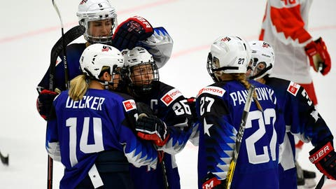 <p>               Team USA celebrates their seventh goal by Kendall Coyne Schofield, center, during the IIHF Women's Ice Hockey World Championships Group A match between the USA and Russia in Espoo, Finland, Tuesday, April 9, 2019. (Antti Aimo-Koivisto/Lehtikuva via AP)             </p>