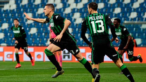 <p>               Sassuolo's Merih Demiral celebrates with his teammates after scoring his team's first goal during the Italian Serie A soccer match between Sassuolo and Chievo Verona at Mapei Stadium in Reggio Emilia, Italy, Thursday, April 4, 2019. (Elisabetta Baracchi/ANSA via AP)             </p>