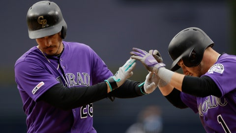 <p>               Colorado Rockies' Nolan Arenado, left, is greeted by Garrett Hampson after hitting a two-run home run during the first inning of the team's baseball game against the San Diego Padres, Tuesday, April 16, 2019, in San Diego. (AP Photo/Gregory Bull)             </p>