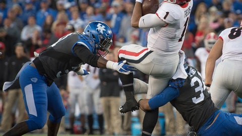 "<p>               FILE - In this Nov. 3, 2018, file photo, Georgia quarterback Justin Fields (1) is tackled by Kentucky linebacker Jordan Jones (34) and linebacker Jamar Watson (31) during the second half an NCAA college football game in Lexington, Ky. ""Of course, not having them, it's a difference,"" Watson said of his predecessors, who many of whom could be selected in the NFL draft. ""But that gives us a lot of confidence going into the season that coach (Mark) Stoops and the rest of defensive staff can groom us and take that step."" (AP Photo/Bryan Woolston, File)             </p>"