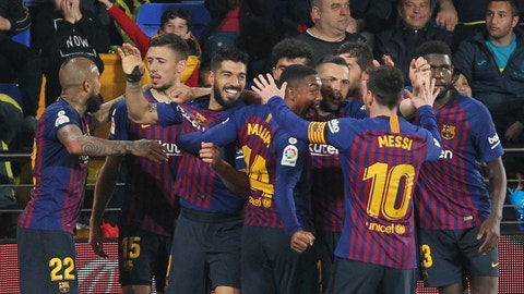 <p>               Barcelona forward Luis Suarez celebrates with teammates after scoring his side's fourth goal during the Spanish La Liga soccer match between Villarreal and FC Barcelona at the Ceramica stadium in Villarreal, Spain, Tuesday, April 2, 2019.(AP Photo/Alberto Saiz)             </p>