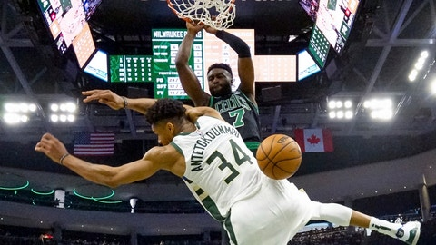 <p>               Boston Celtics' Jaylen Brown dunks over Milwaukee Bucks' Giannis Antetokounmpo during the second half of Game 1 of a second round NBA basketball playoff series Sunday, April 28, 2019, in Milwaukee. The Celtics won 112-90 to take a 1-0 lead in the series. (AP Photo/Morry Gash)             </p>