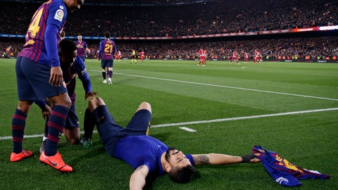 <p>               Teammate hug Barcelona forward Luis Suarez, on the pitch, after he scored his side's first goal during a Spanish La Liga soccer match between FC Barcelona and Atletico Madrid at the Camp Nou stadium in Barcelona, Spain, Saturday April 6, 2019. (AP Photo/Manu Fernandez)             </p>