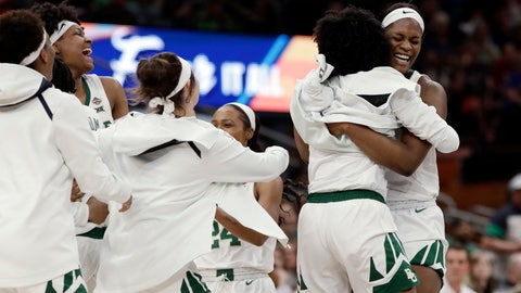 <p>               Baylor center Kalani Brown hugs forward NaLyssa Smith, right, as teammates celebrate on the court during the second half against Oregon in a Final Four semifinal of the NCAA women's college basketball tournament Friday, April 5, 2019, in Tampa, Fla. Baylor defeated Oregon 72-67. (AP Photo/Chris O'Meara)             </p>