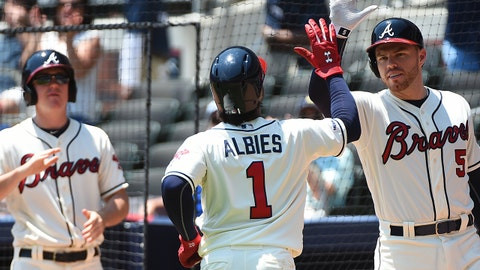ATLANTA, GEORGIA - APRIL 28: Ozzie Albies #1 of the Atlanta Braves celebrates hitting a leadoff home run against the Colorado Rockies at SunTrust Park on April 28, 2019 in Atlanta, Georgia. (Photo by Logan Riely/Getty Images)