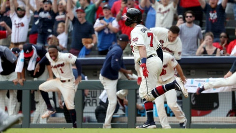 Apr 7, 2019; Atlanta, GA, USA; Fans and players react after a game-winning walk-off single by Atlanta Braves shortstop Dansby Swanson (7) to score first baseman Freddie Freeman (not pictured) in the ninth inning against the Miami Marlins at SunTrust Park. Mandatory Credit: Jason Getz-USA TODAY Sports