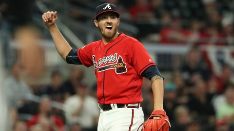 Apr 5, 2019; Atlanta, GA, USA; Atlanta Braves starting pitcher Kevin Gausman (45) reacts after a double play to end the top of the seventh inning against the Miami Marlins at SunTrust Park. Mandatory Credit: Jason Getz-USA TODAY Sports