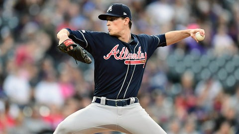 Apr 9, 2019; Denver, CO, USA; Atlanta Braves starting pitcher Max Fried (54) delivers a pitch in the first inning against the Colorado Rockies at Coors Field. Mandatory Credit: Ron Chenoy-USA TODAY Sports
