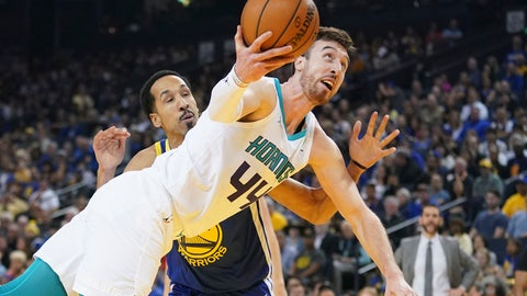 March 31, 2019; Oakland, CA, USA; Charlotte Hornets forward Frank Kaminsky (44) shoots the basketball against Golden State Warriors guard Shaun Livingston (34) during the second quarter at Oracle Arena. Mandatory Credit: Kyle Terada-USA TODAY Sports