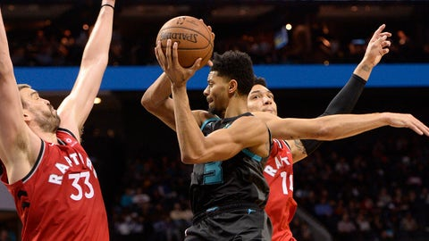Apr 5, 2019; Charlotte, NC, USA; Charlotte Hornets guard forward Jeremy Lamb (3) passes the ball as he is defended by Toronto Raptors center Marc Gasol (33) and guard forward Danny Green (14) during the second half at the Spectrum Center. Hornets won 113-111. Mandatory Credit: Sam Sharpe-USA TODAY Sports