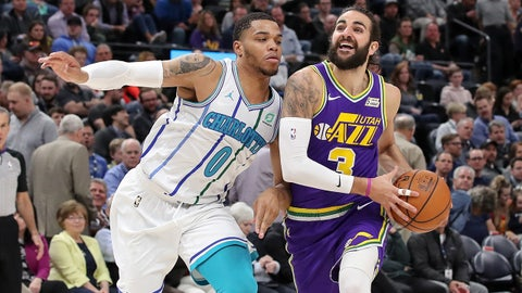 Apr 1, 2019; Salt Lake City, UT, USA; Utah Jazz guard Ricky Rubio (3) controls the ball past Charlotte Hornets forward Miles Bridges (0) during the third quarter at Vivint Smart Home Arena. Mandatory Credit: Chris Nicoll-USA TODAY Sports